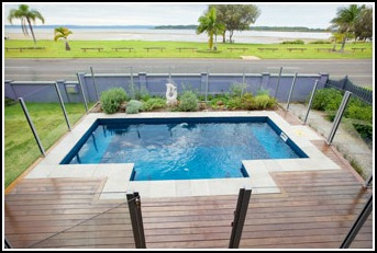 Nirvana Plunge Pool in a courtyard setting with wooden deck surround and glass fencing