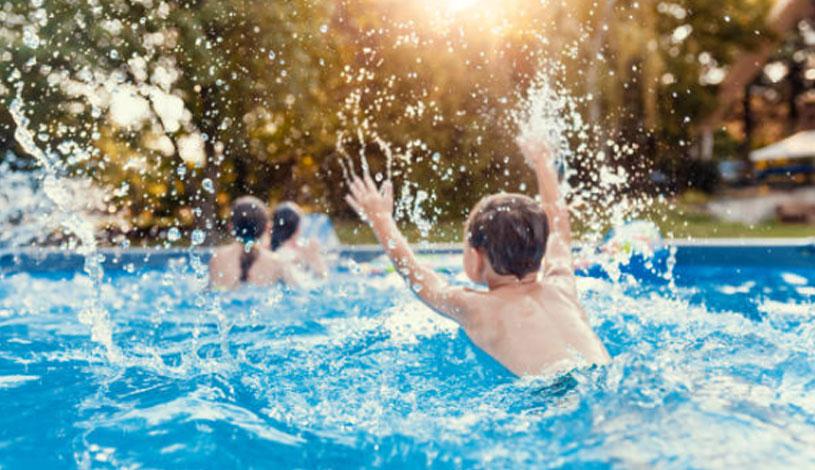 Swimming in Backyard Fibreglass Pool