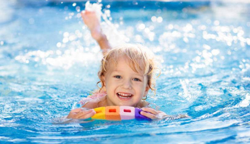 Child Swimming in Fibreglass Pool