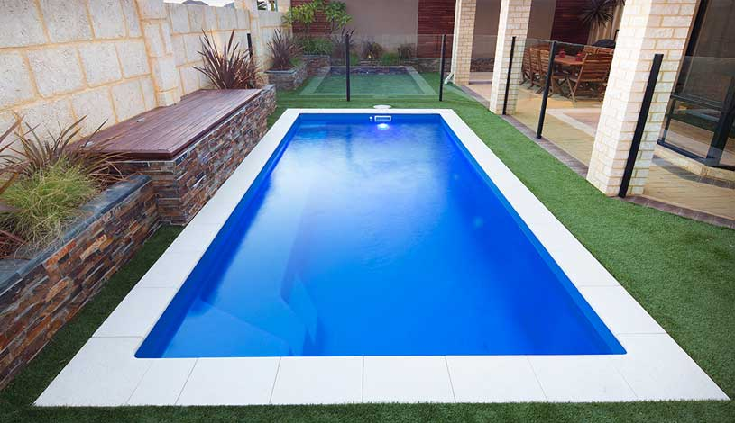 In-Ground Fibreglass Pool In Backyard