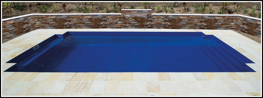 Photo of Classic family sized inground fibreglass pool in a courtyard pool setting